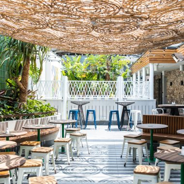 A beautiful outdoor rooftop beer garden with lots of sunshine