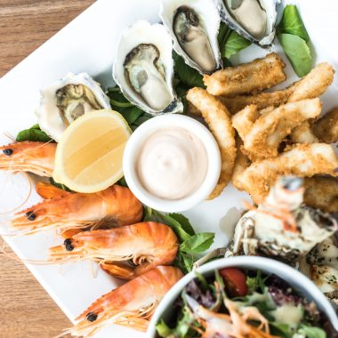 A seafood platter with prawsn, oysters and lobster