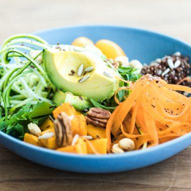 A vegan salad in a blue bowl